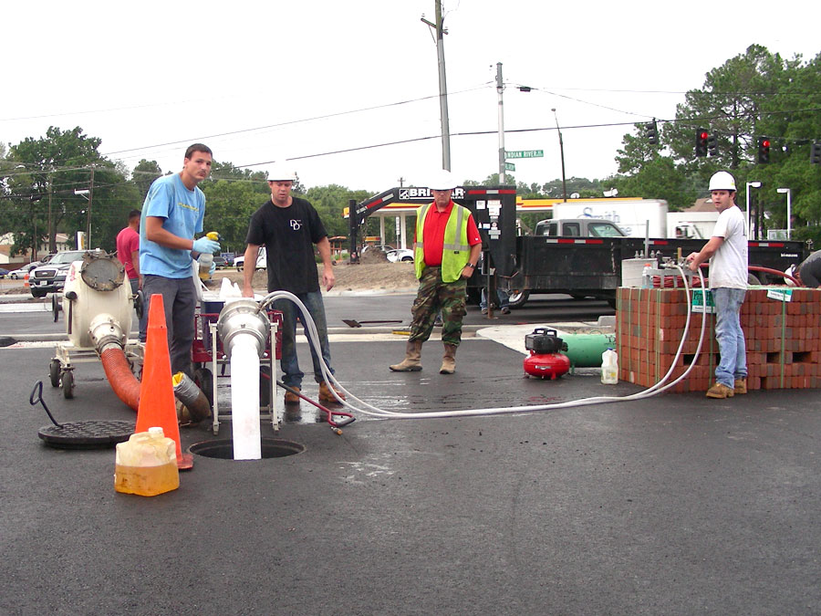 Inverting the liner into the sewer