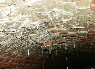 water infiltration into a leaking sewer system